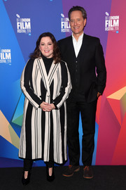 Melissa McCarthy looked stylish in a black-and-white striped coat while attending a Q&A session at the BFI London Film Festival.
