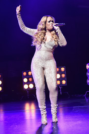 Faith Evans performed at the Tribeca Film Fest premiere of 'Can't Stop, Won't Stop' wearing a figure-hugging gold jumpsuit.