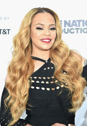 Faith Evans showed off flowing mermaid waves at the Tribeca Film Fest premiere of 'Can't Stop, Won't Stop.'