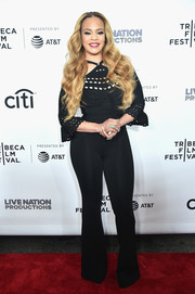 Faith Evans wrapped up her curves in a cold-shoulder bandage jumpsuit by Herve Leger for the Tribeca Film Fest premiere of 'Can't Stop, Won't Stop.'