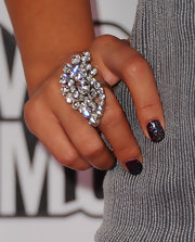 Vanessa Hudgens' multi-colored metallic manicure was a playful element of her otherwise super sophisticated look at Candie's 2011 MTV Video Music Awards after party. To create her look, use a deep shade of polish like OPI 'Opening Night' sealed with a coat of Nail Inc. Holographic Glitter Topcoat.