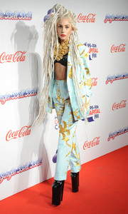 Lady Gaga strutted into the Capital FM Jingle Bell Ball wearing a custom Versace pantsuit and a black lace bra.