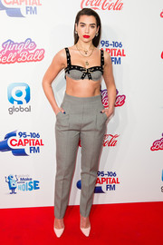 Dua Lipa joined Capital's Jingle Bell Ball rocking a glammed-up bra by Philosophy di Lorenzo Serafini.