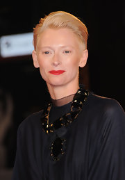 Tilda paired her draped gown with a stunning black geometric crystal necklace