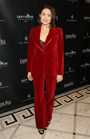 Megan Boone looked sharp in a red pantsuit teamed with a black lace top during the Capitol File holiday issue celebration.