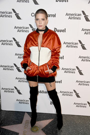 Halsey ditched the pants in favor of black suede thigh-high boots.