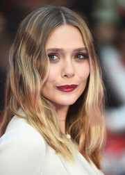 Elizabeth Olsen hit the 'Captain America: Civil War' European premiere sporting a boho wavy 'do.