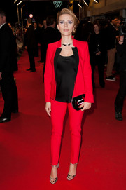 Scarlett Johansson made menswear look so sexy in this bright red Michael Kors pantsuit during the 'Captain America' Paris premiere.