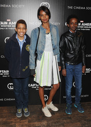 Liya Kebede toughened up her dress with a faded denim jacket during the 'Captain America' screening.