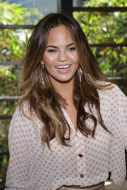 Chrissy Teigen sported tousled wavy layers during the SI Swimsuit 50th anniversary poolside celebration.