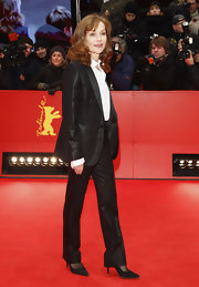 Isabelle Huppert opted for an iridescent black tux instead of a gown at the 'Captive' premiere.