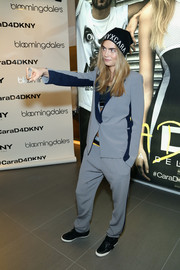 Cara Delevingne went for a sporty, masculine vibe in a gray and blue Cara D for DKNY pantsuit during the collection's launch.