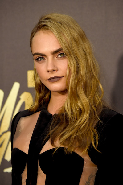 Cara Delevingne Long Wavy Cut [hair,blond,beauty,human hair color,hairstyle,model,lady,girl,long hair,fashion model,arrivals,cara delevingne,actress,mtv movie awards,burbank,pt,california,warner bros. studios]