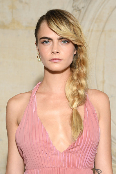 Cara Delevingne Loose Braid [hair,blond,hairstyle,face,beauty,long hair,lip,pink,chin,eyebrow,christian dior,cara delevingne,actor,rapper,hairstyle,part,hair,celebrity,paris fashion week womenswear fall,photocall - paris fashion week womenswear fall,cara delevingne,film,news,model,actor,hairstyle,rapper,glamour,celebrity]