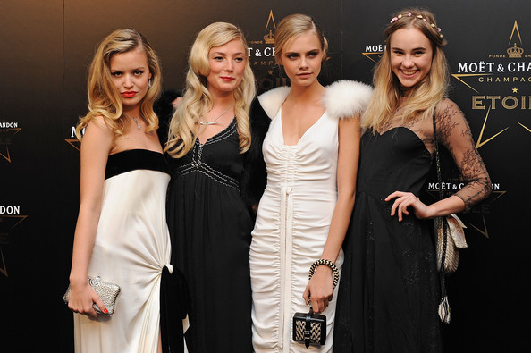 Cara Delevingne Leather Wristlet [dress,fashion,beauty,lady,event,blond,model,fashion model,cocktail dress,haute couture,mario testino,georgia may jagger,clara paget,cara delevigne,l-r,moet chandon etoile,society,park lane hotel,moet chandon etoile award - gala ceremony,award ceremony]