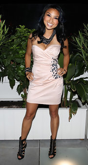 Jeannie Mai contrasted her cute dress with edgy black gladiator heels when she attended the Fashion's Night Out event.