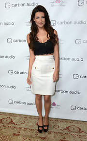 Jacqueline MacInnes Wood's black eyelet crop top and white pencil skirt at the Zooka launch party really played up her fab figure.