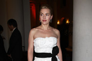 (UK TABLOID NEWSPAPERS OUT) Charity ambassador and host Kate Winslet arrives at the Cardboard Citizens Gala Fundraising Dinner wearing a dress by french couture house Max Chaoul which she donated to the event as one of the star auction lots of the night held at Christ Church Spitalfields on March 19, 2011 in London, England.
