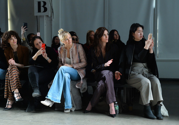 More Pics of Hilary Rhoda Pantsuit (1 of 25) - Suits Lookbook - StyleBistro [winter 2018 runway show,social group,fashion,sitting,youth,event,human,design,fun,performance,fashion design,malin akerman,hilary rhoda,carlisle fall,front row,new york city,pier 59 studios,new york fashion week]