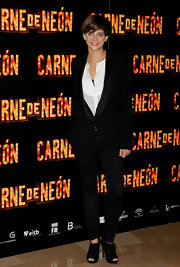 Macarena looks sophisticated at a Madrid photo call in a tuxedo style blazer.