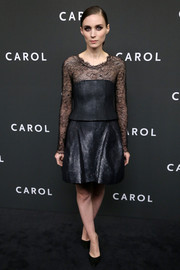 Rooney Mara completed her outfit with a flared black mini skirt, also by Chanel Couture.