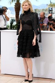 For added style, Cate Blanchett teamed her LBD with a black Alexander McQueen leather jacket with sheer inserts.
