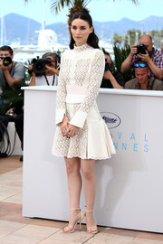 Rooney Mara was demure and stylish in a long-sleeve white lace-panel dress by Alexander McQueen at the 'Carol' photocall in Cannes.
