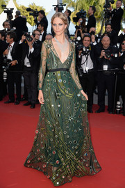 Poppy Delevingne went for whimsical glamour at the 'Carol' premiere in a deep-V green Burberry Prorsum gown adorned with mirror accents and star embroidery.