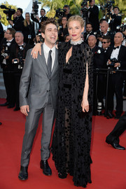Sienna Miller was a goth beauty in a star-embellished black cape and dress combo by Sonia Rykiel at the 'Carol' premiere in Cannes.