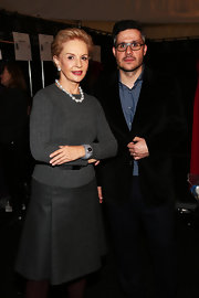 Carolina Herrera showed off her classic style with a simple gray sweater with a belt for added fit.
