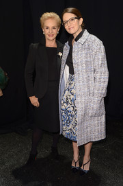 Tina Fey layered a stylish tweed coat over a blouse and skirt combo for the Carolina Herrera fashion show.