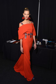 Karlie Kloss looked darling in an embellished orange Carolina Herrera gown with draped sleeves during the label's fashion show.