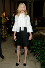 Kate Bosworth looked cute and demure in a white Carolina Herrera pussybow blouse with bell sleeves during the brand's fashion show.