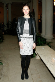 Hilary Rhoda styled her dress with a boxy black leather jacket.