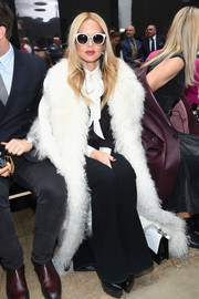 Rachel Zoe attended the Carolina Herrera runway show looking quite the fashionista in a white fur coat from her label.