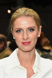 Nicky Hilton Rothschild stayed classic with this brushed-back bun at the Carolina Herrera fashion show.