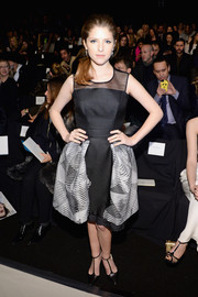 Anna Kendrick chose a Carolina Herrera cocktail dress featuring a sheer yoke and a puffy skirt for the label's fashion show.