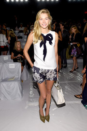 Jessica Hart attended the Carolina Herrera fashion show wearing an adorable sleeveless white top embellished with a large black bow.