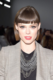 Coco Rocha sported a sleek short 'do with blunt bangs at the Carolina Herrera Spring 2015 show.