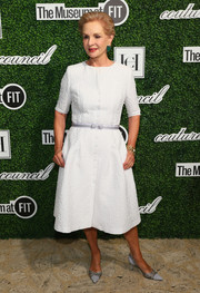 Carolina Herrera opted for a textured white button-up dress when she attended the Couture Council Award luncheon.