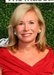 Sharon Bush styled her hair with wavy ends and side-swept bangs for the Couture Council Award luncheon.