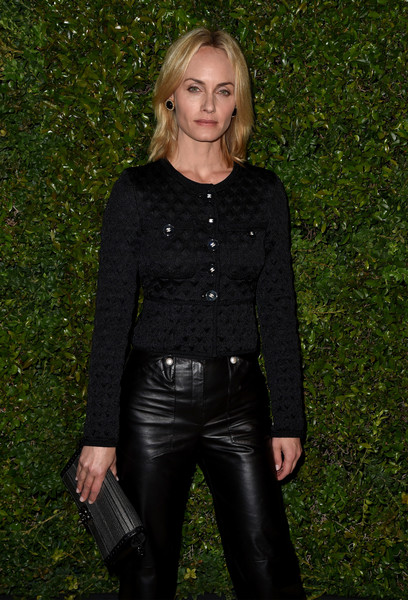 Amber Valletta accessorized with a metallic clutch by Chanel when she attended the Gabrielle bag celebration.