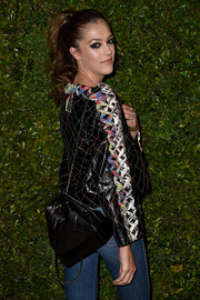 Sistine Rose Stallone showed off a luxurious quilted backpack by Chanel at the Gabrielle bag celebration.