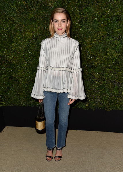 Kiernan Shipka polished off her look with strappy, chain-embellished sandals by Chanel.