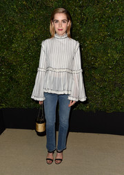 Kiernan Shipka looked darling in a loose white Chanel blouse with black trim and ruffle accents during the Gabrielle bag celebration.