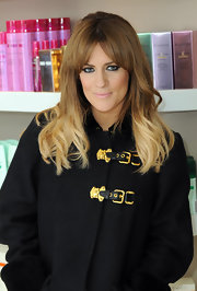 Caroline updated her signature ombre hairstyle with some cute bangs parted in the center.