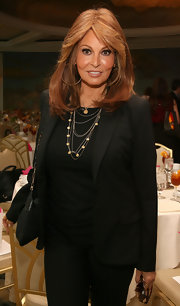 Raquel Welch styled her plain black ensemble with a layered gold necklaces at the Carousel of Hope kickoff luncheon.
