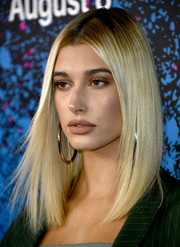 Hailey Baldwin finished off her look with a nude lip.