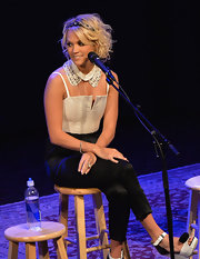 Carrie Underwood opted for a cool menswear-inspired corset jumpsuit, which she paired with a white collar necklace.