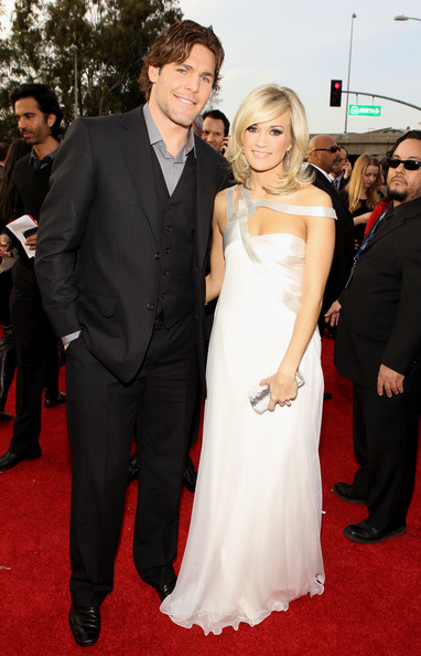 Carrie Underwood Engagement Ring [red carpet,carpet,dress,gown,flooring,clothing,premiere,suit,event,shoulder,arrivals,carrie underwood,mike fisher,r,california,los angeles,staples center,52nd annual grammy awards]